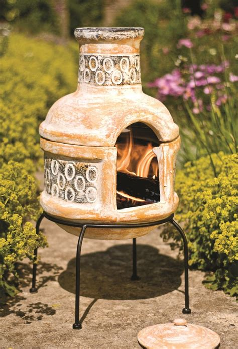 clay chimenea transfoms to barbeque patio heater bbq