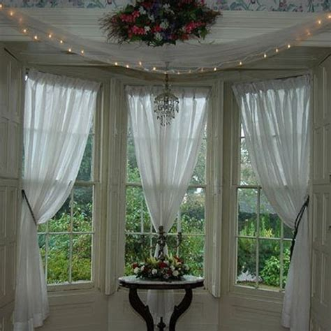 how to put curtains on bay windows dining room bay window curtains 187 ideas home design