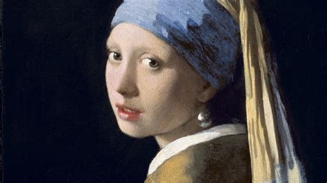 themes girl with a pearl earring vermeer s woman in blue brings her mystery allure to l