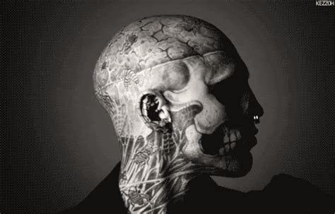 tattoo assassins gif piercing rick genest gif find share on giphy
