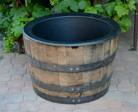Barrel With Planter by 1 2 Planter Whiskey Barrel With Liner