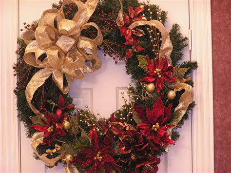 garland ideas a poinsettia and pine cone wreath would look wonderfully