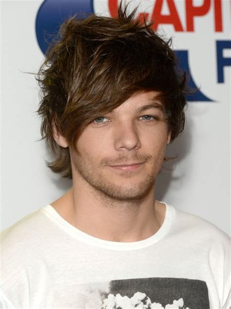 louis tomlinson red carpet tell us louis is making you weak at the knees too