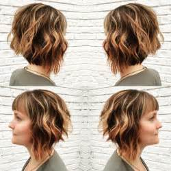 diagonal bob haircut curly hair angled bob hairstyle with bangs short layered wavy