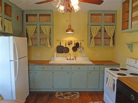 1930's kitchen  curtains on cabinets   Kitchen ideas