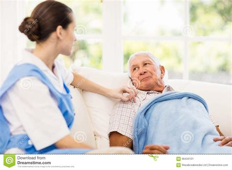taking care of sick elderly patient stock photo