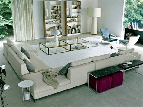 a living room with two loveseats creating interiors combines living room furniture sofa designs elegance and