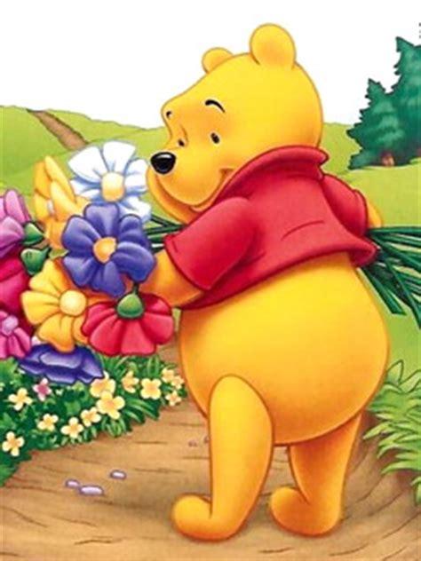 imagenes de winnie pooh con flores winnie pooh cargando un ramillete de flores de colores