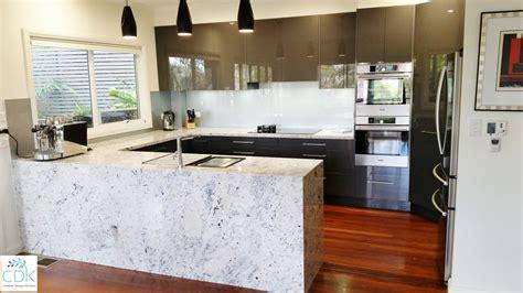 white stone bench tops streamlined kitchens handless kitchens cdk
