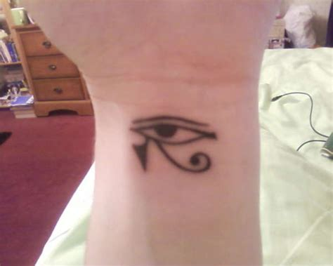 black ink horus eye tattoo on left wrist