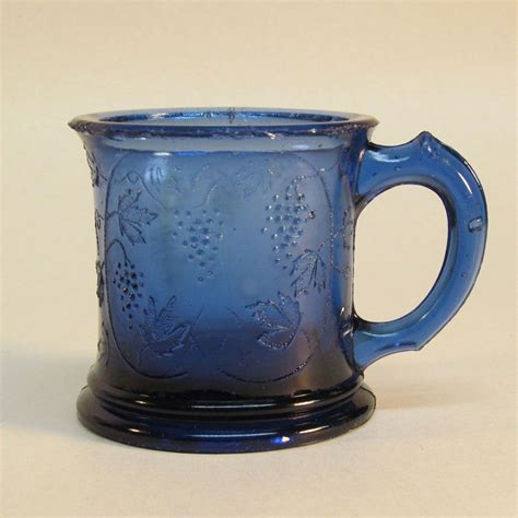 cobalt blue glass l cobalt blue pressed glass grape pattern child s mug from