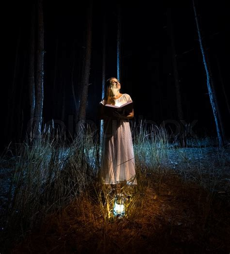 Mysterious Shot Of Beautiful Woman In Nightgown Reading