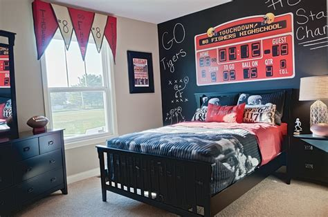 boy s sports themed bedroom with scoreboard and chalkboard