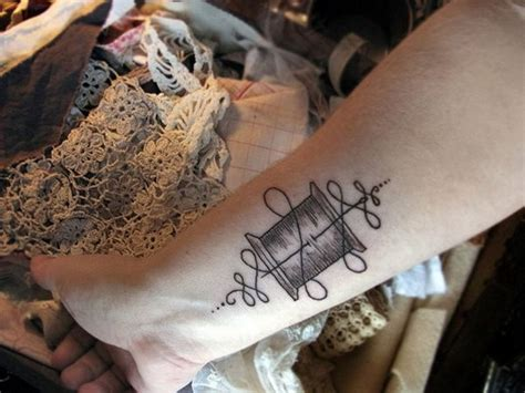 needle and thread tattoo 47 stylish cross tattoos for wrists