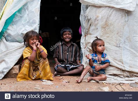 poor indian and boy sitting at the entrance of
