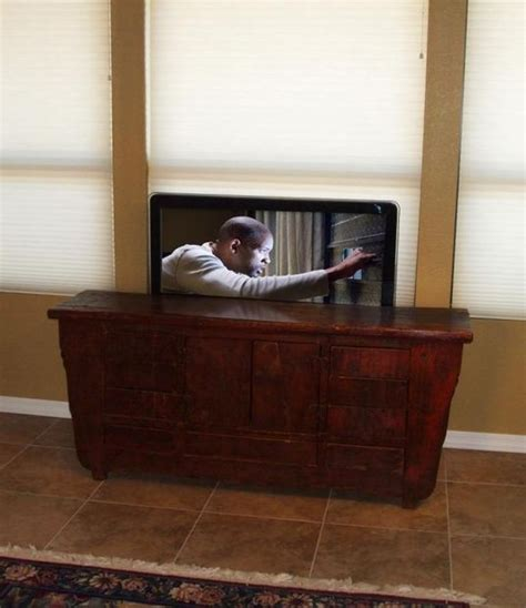 Pop Up Tv That Hides In The Fireplace by Disappearing Tv With Pop Up Tv Lift Mounted Furniture
