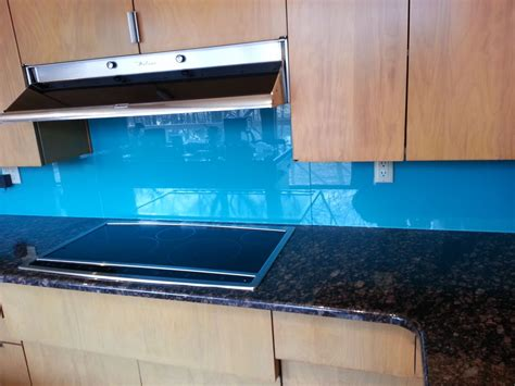 colored glass backsplash 7 cool uses of glass in a contemporary luxury home