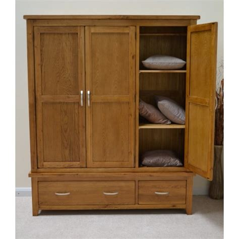Storage Drawers For Wardrobes by Rustic Oak 3 Door Wardrobe With Storage Drawers