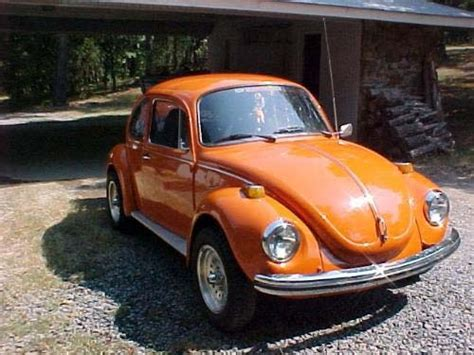 orange volkswagen beetle 1970 super beetle i can imagine myself driving around