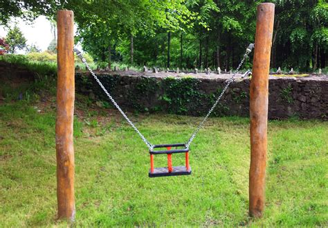 a child swings on a playground swing mini toddler swing with cradle seat 4 016 the children