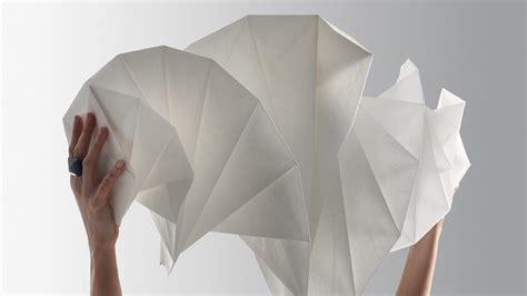 Issey Miyake Origami - issey miyake turns plastic bottles into glowing origami