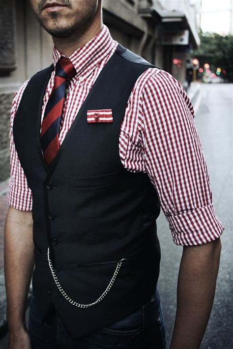 striped tie and checkered shirt beneath an elegant grey men s navy waistcoat white and red gingham dress shirt