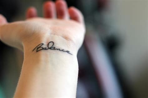 one word wrist tattoos balance wrist like the font and placement