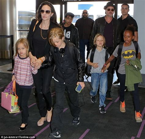 New Photo Of The Pitt Family by And Brad Pitt Walk Through Lax With