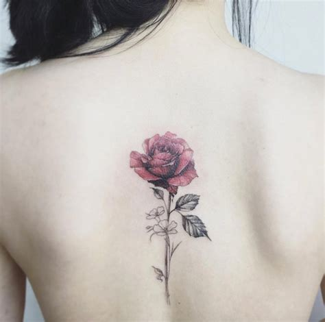 single rose tattoo picture of single on a back