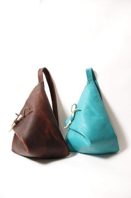 turquoise or brown leather triangle bag by