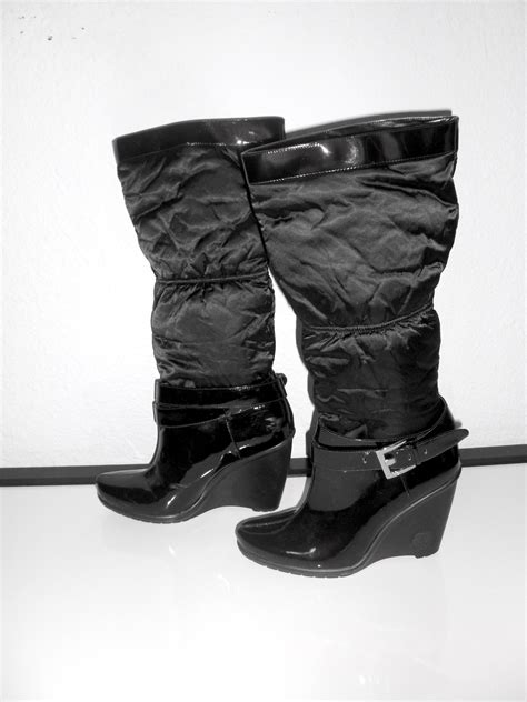 used bcbg black patent leather boots side view swanky