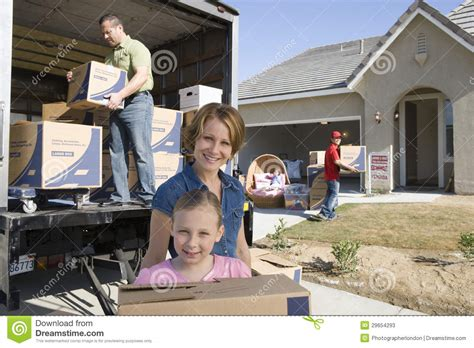 moving into a new house family moving into new house stock photos image 29654293