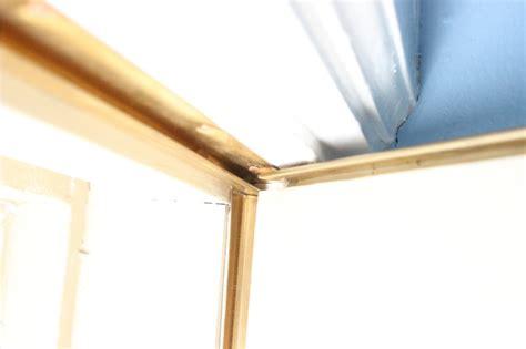 metal weathervane and decorative wooden window modernization storm windows and window restoration