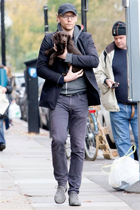 tom hiddleston puppy tom hiddleston holds his new puppy in for all to see tom lorenzo