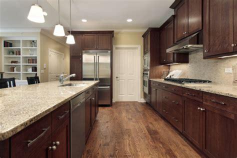 dark cabinets light countertops santa cecelia granite granite countertops granite slabs
