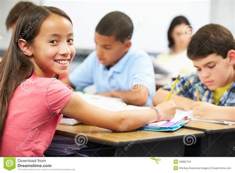 Child S Writing Desk Pupils Studying At Desks In Classroom Stock Images Image