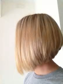 back view of mid length hair bob layered bob hairstyles with bangs for medium length hair