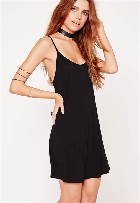 black strappy swing dress missguided strappy swing dress black in black lyst