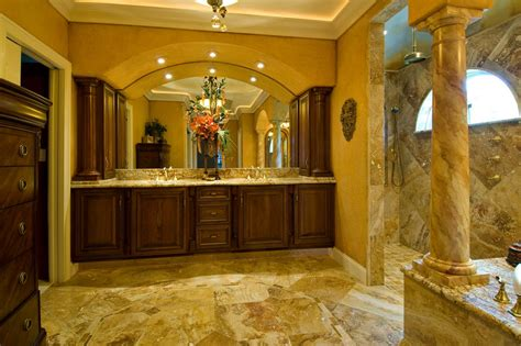 grand tuscan style bathroom with large wood vanity hgtv
