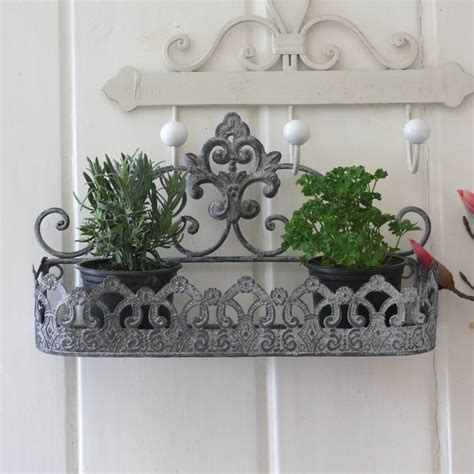 aged ornate wall planter by magpie living