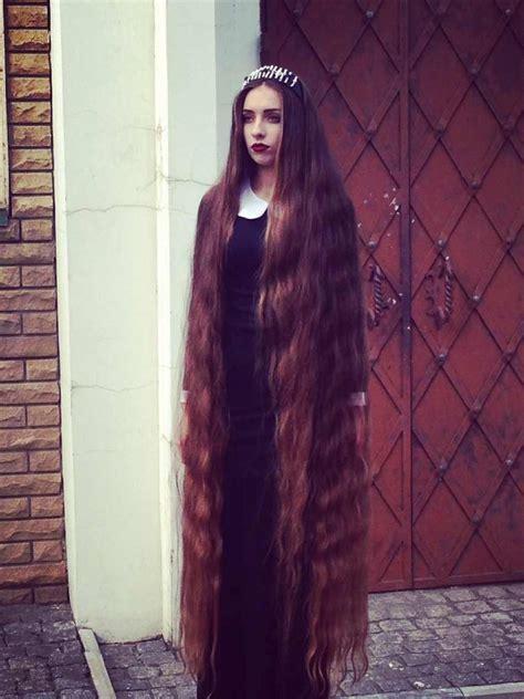 very long floor length hair long hair girl shows off her floor length hair girls with