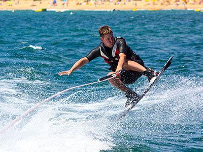 kayak between wakeboard boats ski molhado watersports activities at oura praia albufeira