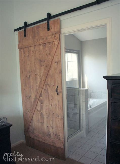 sliding barn door bathroom diy distressed sliding barn door hometalk