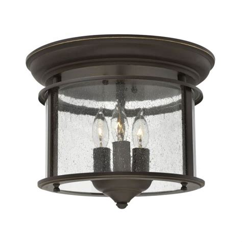 traditional flush fitting bronze hall lantern with clear