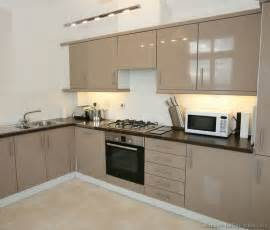 Kitchens featuring beige kitchen cabinets in modern styles take a