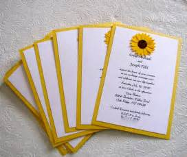 So i designed wedding invitations with a sunflower motif for her