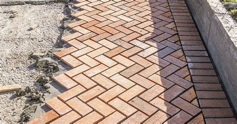 Patio Paver Sand How To Level The Sand Base For Patio Pavers Ehow Uk