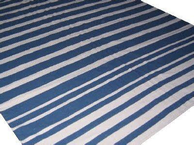 blue and white stripe rug somethings gotta give but it aint the blue and white striped rug completely coastal