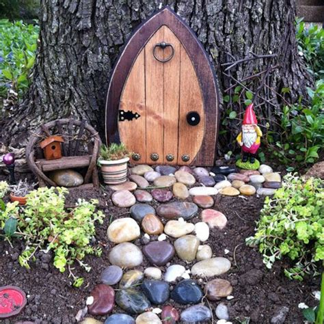 outdoor pixie elves doors in the garden ideal home