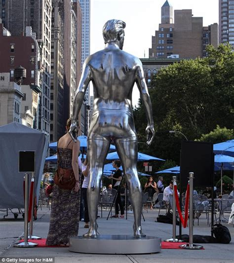 Beckham Immortalized david beckham gets immortalized in a silver statue for h m